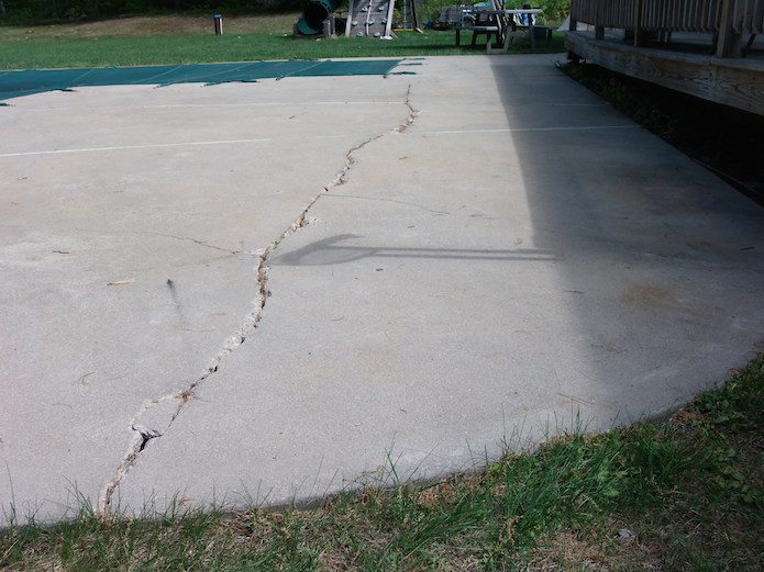cracked concrete pool deck